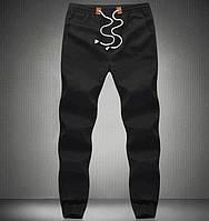 Хлопковые черные брюки на резинке