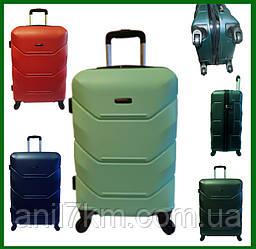Малый ударопрочный чемодан на четырёх колёсах