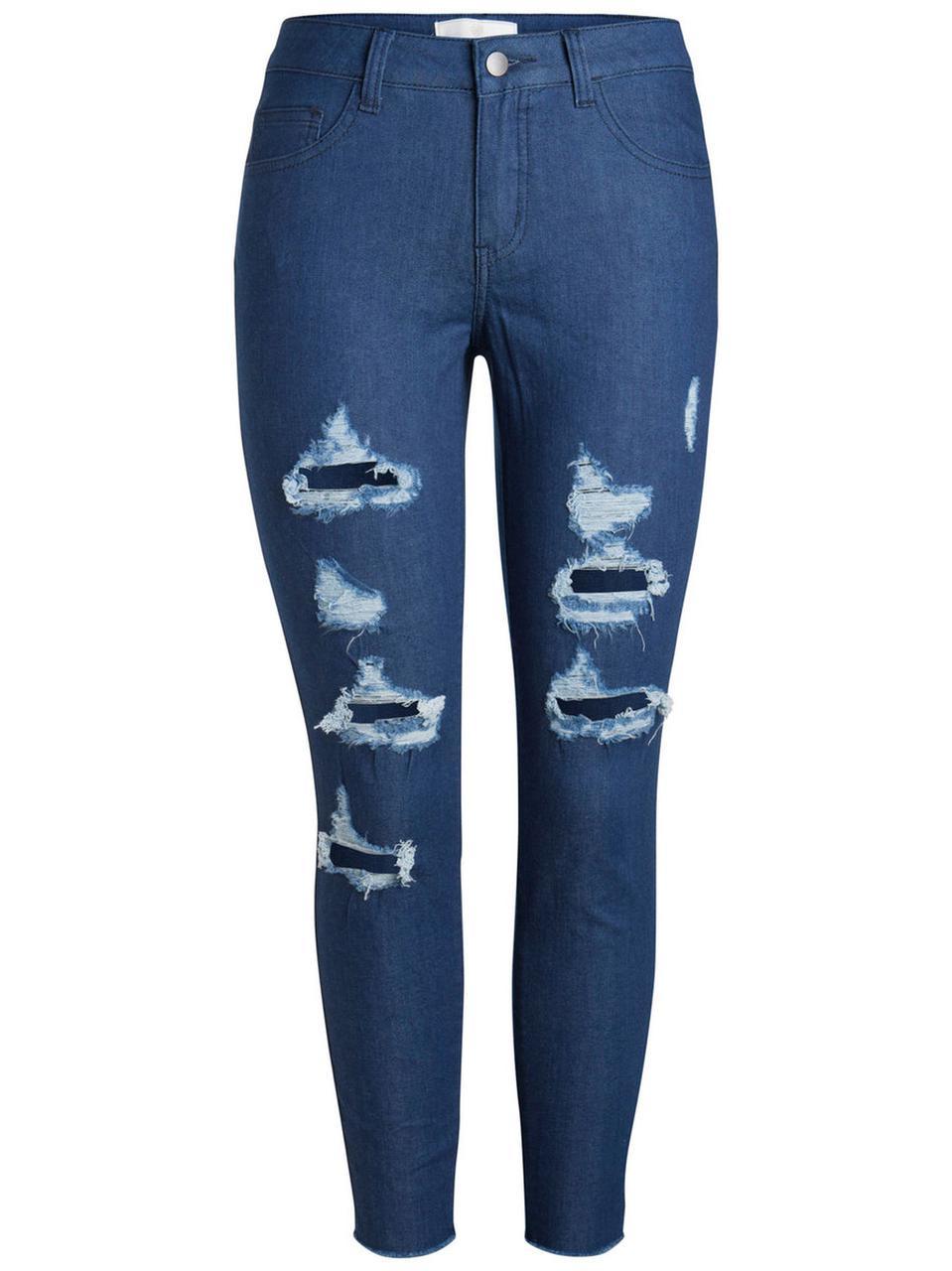 Рваные женские джинсы бренда Pieces в темно синем цвете