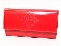 Кожаное портмоне среднего размера фирмы DEKOL