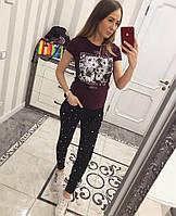 Стильные черные джинсы декорированы жемчугом