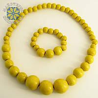 Дерев'яні буси з браслетом із намистин розміром від 11мм до 26мм жовтий