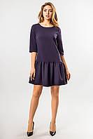 Темно-синее платье с оборкой по низу