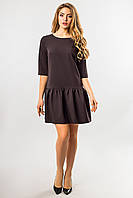 Черное платье с оборкой по низу