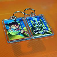 """Брелок """"Keep calm and support Ukraine! Дівчинка з Серцем України"""", купити брелки оптом, брелки з символікою., фото 1"""