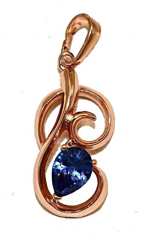 Кулон фирмы ХР. Цвет: позолота с кр.от. Камни: синий циркон. Высота кулона: 2,8 см. Ширина: 11 мм.