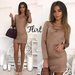 Женское платье с люверсами
