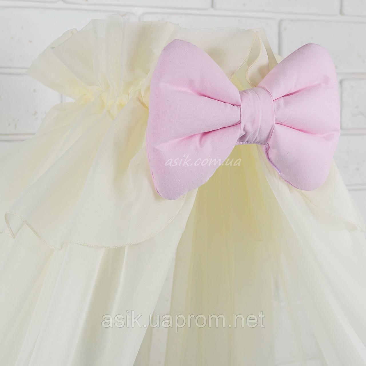Балдахин кремового цвета с розовым бантом для детской кроватки