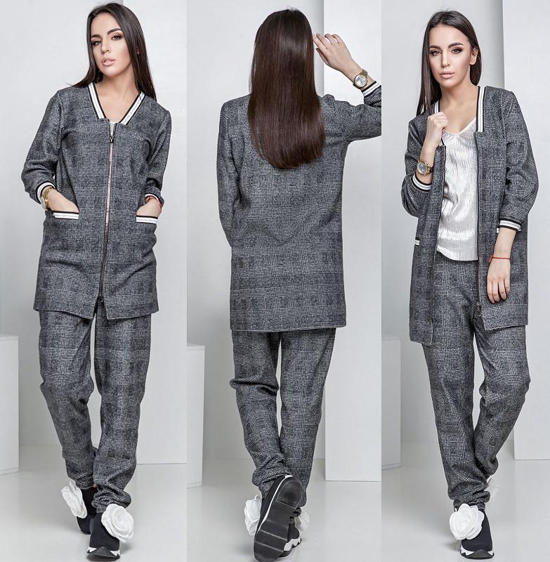 Женский брючный костюм в клетку с прямым пиджаком на двойной молнии ... 0a6a1b9919f4c