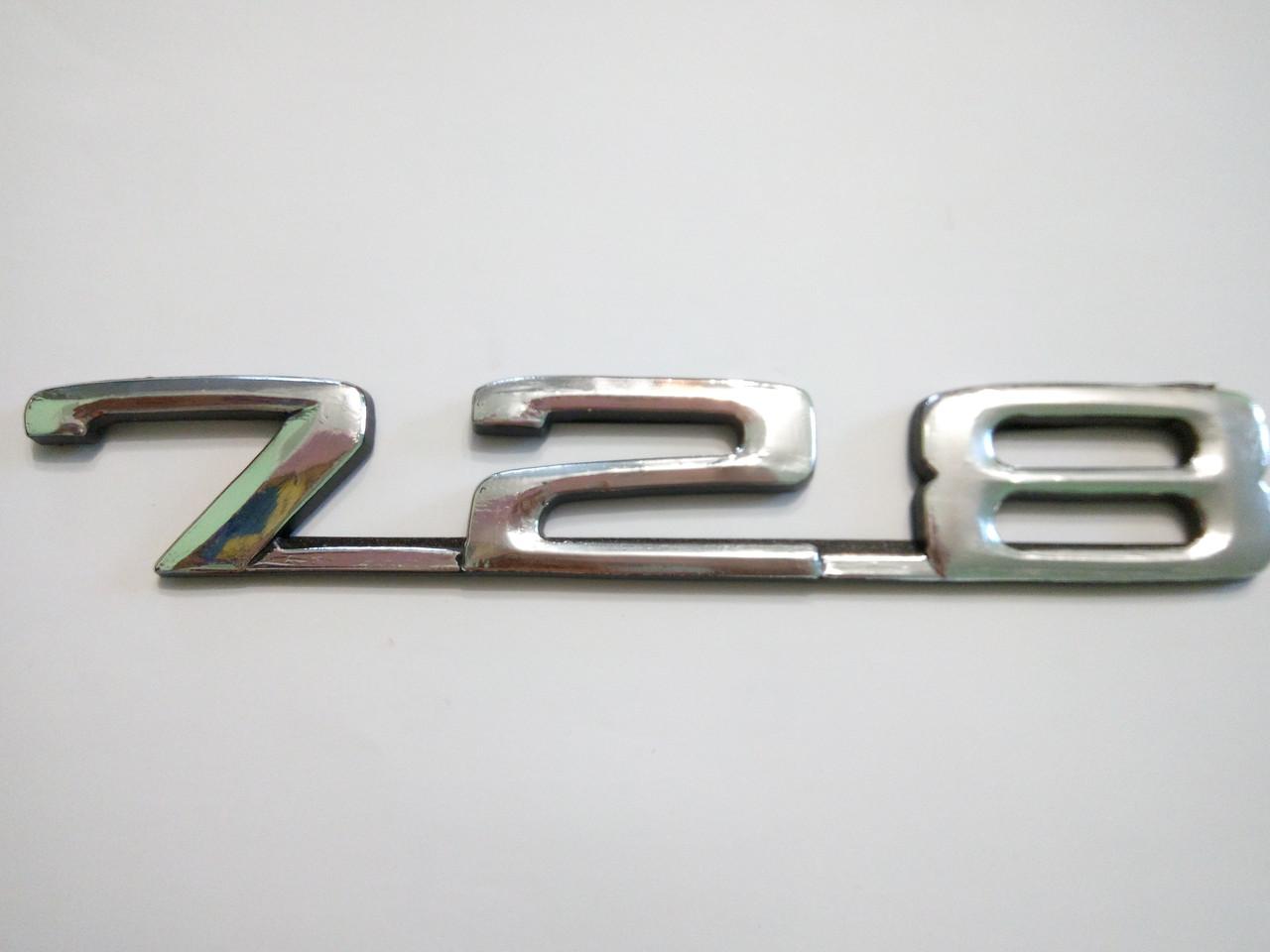 Надпись BMW 728