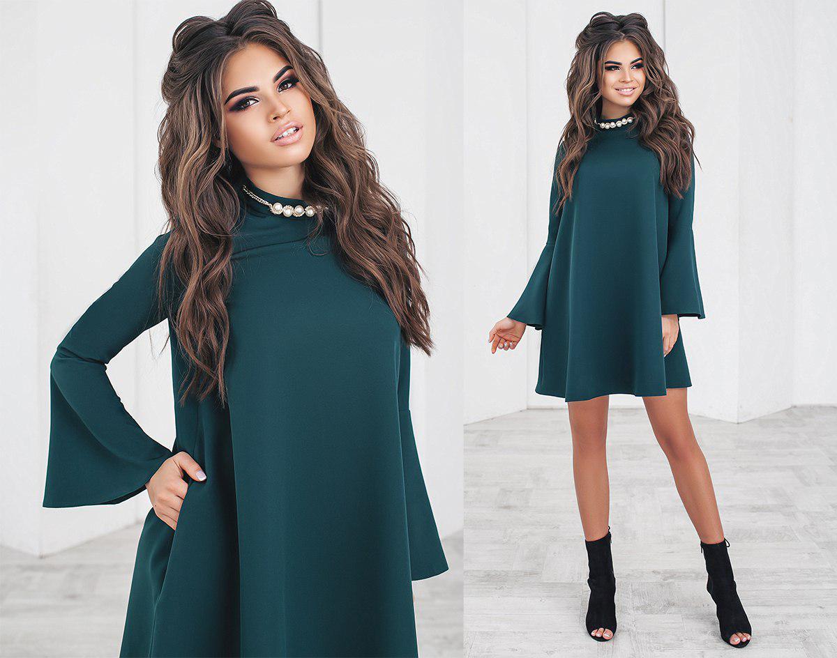 Свободное платье выше колен