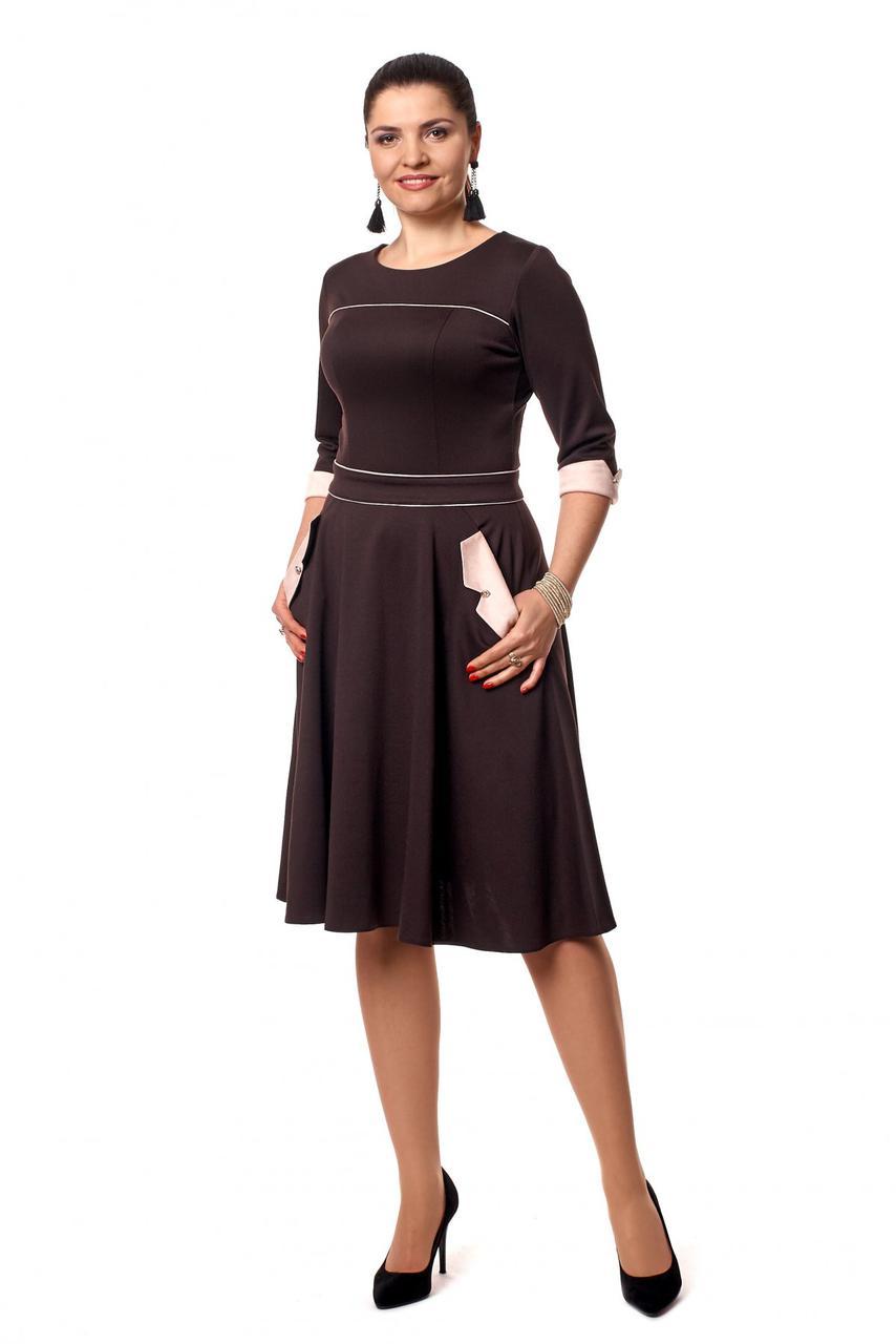 Стильное приталенное трикотажное платье с пышной юбкой
