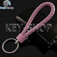 Розовый брелок с кожаным плетёным шнуром и никелированым кольцом