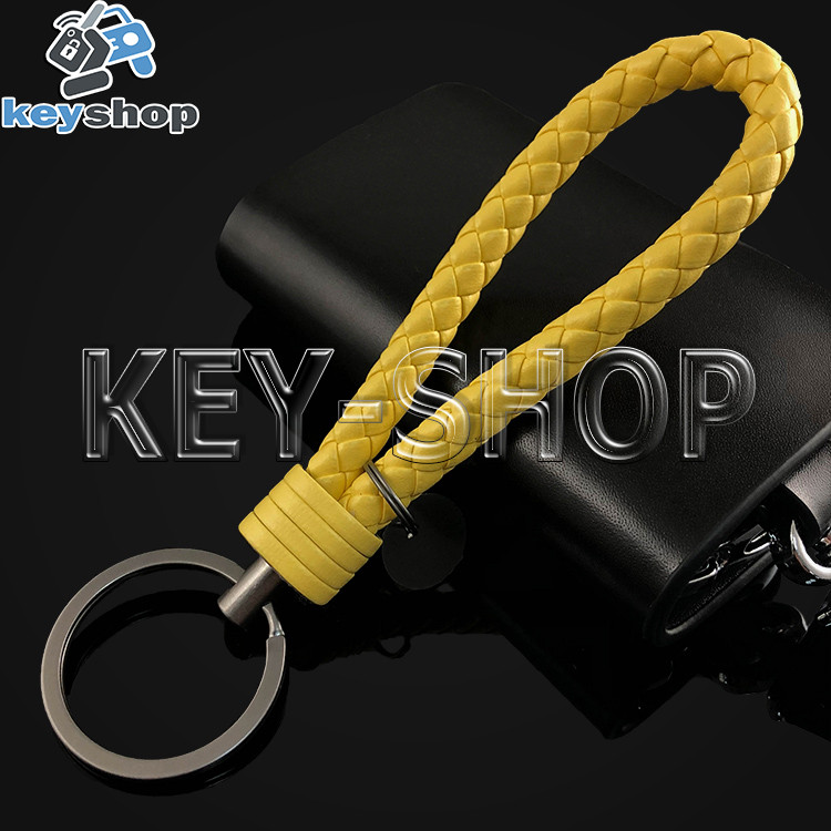 Желтый брелок с кожаным плетёным шнуром и кольцом в темном хроме
