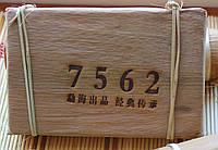 "Пуэр Шу ""7562""  завода Мэнхай 2004 года 250 грамм в бамбуковых листьях"