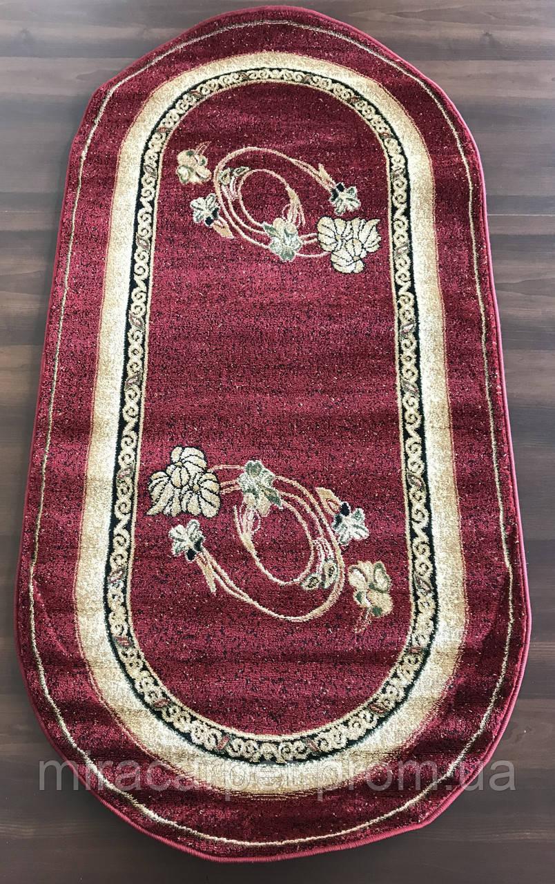 Красные овальные ковры