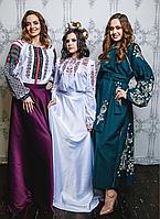 Дизайнерський костюм (зліва)