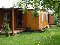 Дачный дом с террасой и хозблоком.