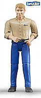 Игрушка Bruder фигурка человека в голубых джинсах 11см