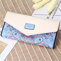 Красивый женский кошелёк с ярким принтом. Голубой