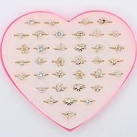 Кольца детские под золото декорированы камушками Упаковка 36 штук