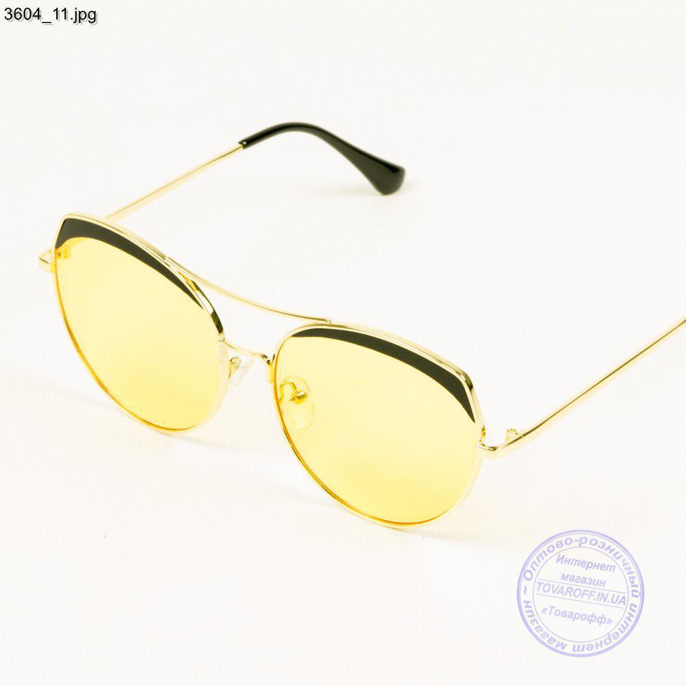 Оптом сонцезахисні окуляри жіночі - Золотисті з жовтими лінзами - 3604/3
