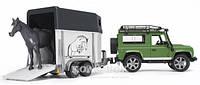 Игрушка Bruder джип  Land Rover Defender с прицепом для перевозки лошадей + лошадка М1:16