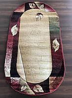 Бежево-красный овальный ковер на кухню