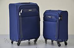 Чемодан дорожный Paklite Rom M 4 колеса, синяя
