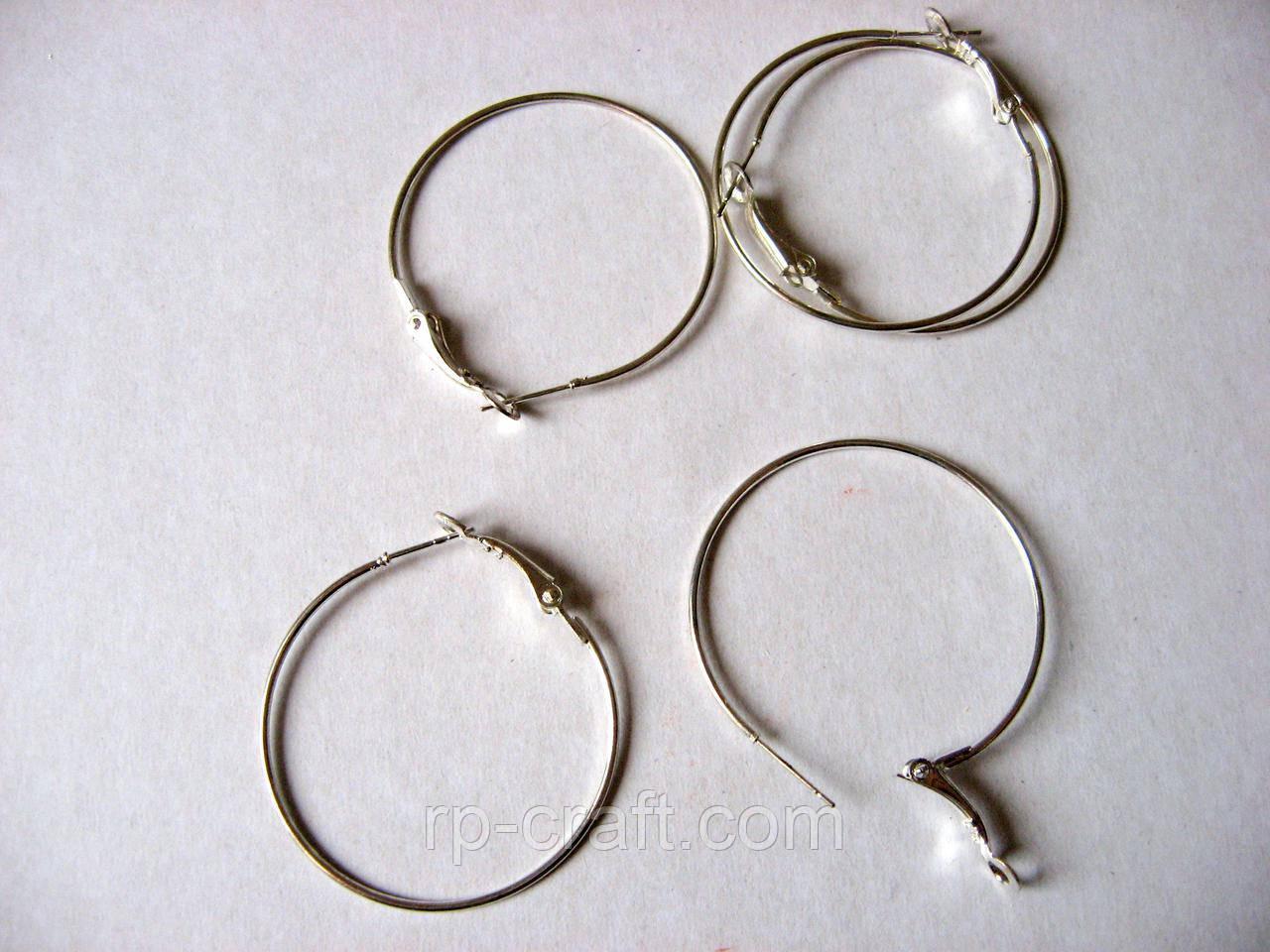 Кольцо для сережек. Серебрянного цвета.  Цена за штуку.