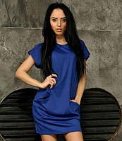 Синее женское трикотажное платье с карманами