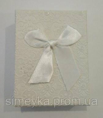 Коробочка подарункова з білим бантиком 7 см * 9 см.