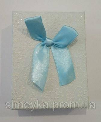 Коробочка подарункова з голубим бантиком 7 см * 9 см.
