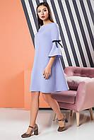 Нежно-голубое расклешенное платье с бархатными лентами