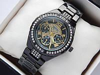 Женские наручные часы Guess черного цвета, золотистый циферблат