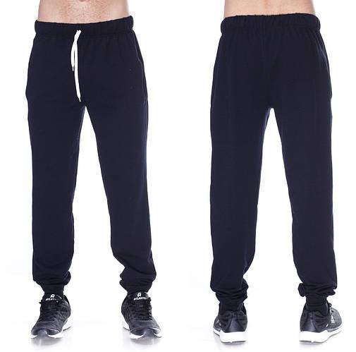 Темно синие спортивные брюки мужские трикотажные на резинке внизу (манжет)
