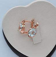 Серьги фирма Xuping Капля с голубыми цирконами розовая позолота 18к.