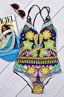 Модный, сдельный, женский купальник с ярким, цветочным принтом и чашечками.