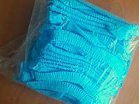 Шапочки одноразові на резинках блакитні