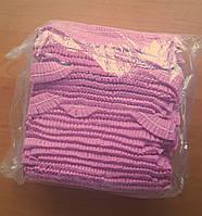 Шапочки одноразові на резинках рожева