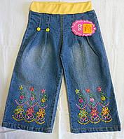 Джинсы с цветочной вышивкой