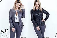 Стильная женская курточка с выбитым внизу рисунком