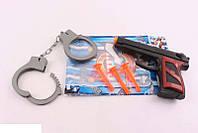 Пистолет на присосках с наручниками