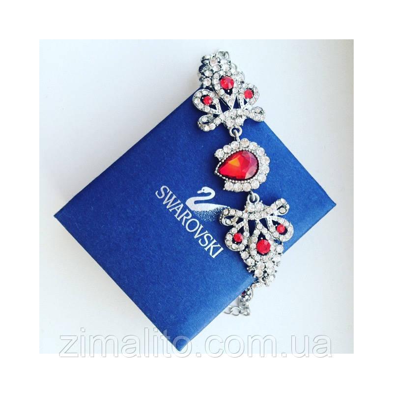 Браслет серебристый в стиле Swarovski с красными камнями и белыми стразами
