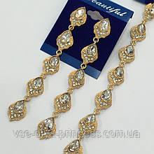 Комплект удлиненные вечерние серьги  и браслет под золото,  высота 11 см.