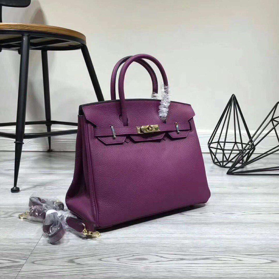 Бредовая сумка фиолетового цвета из натуральной кожи