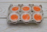 Свеча декоративная у форме половинки яйца с желтком