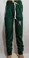 Спортивные штаны для мальчика на 13-16 лет зеленого цвета на манжете оптом