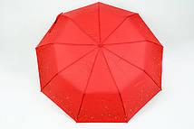 Красный зонт в золотистые звезды
