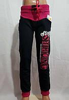 Спортивные штаны для девочки 9-12 лет черно-малинового цвета с надписью оптом